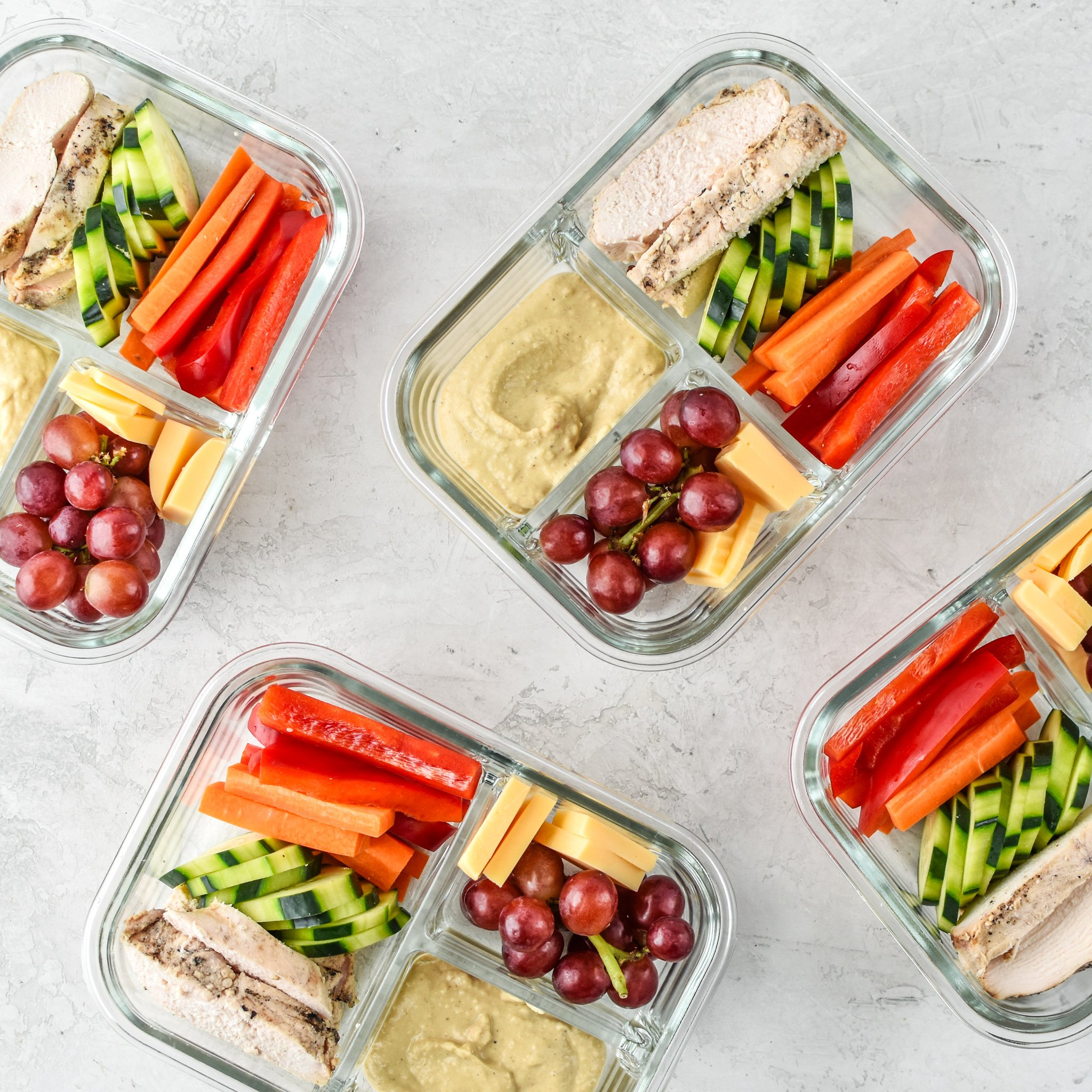 Four Chicken & Hummus Plate Lunch Meal Prep meals ready to be eaten!