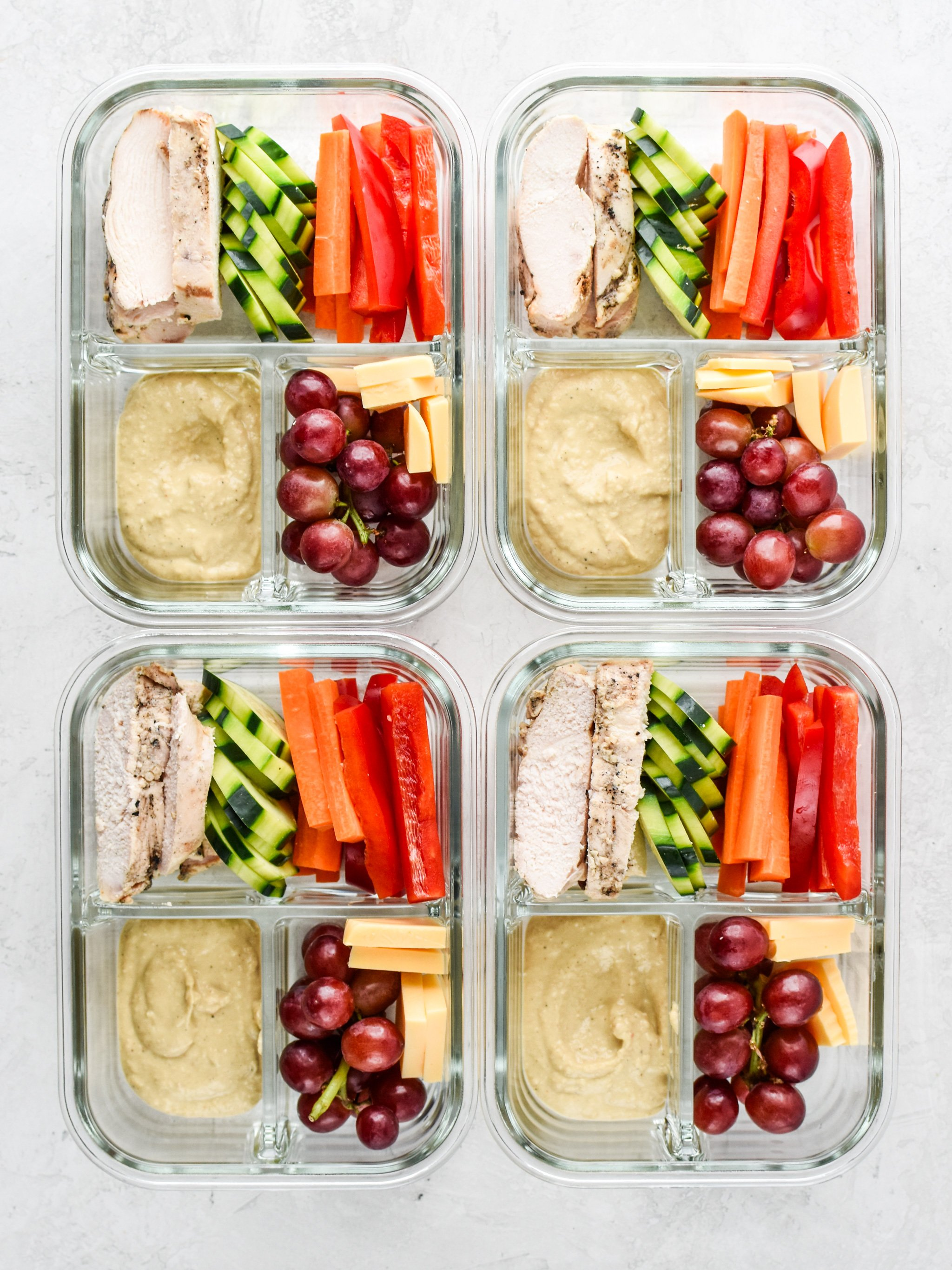 Chicken & Hummus Plate Lunch Meal Prep lunches with chicken, vegetables and hummus.