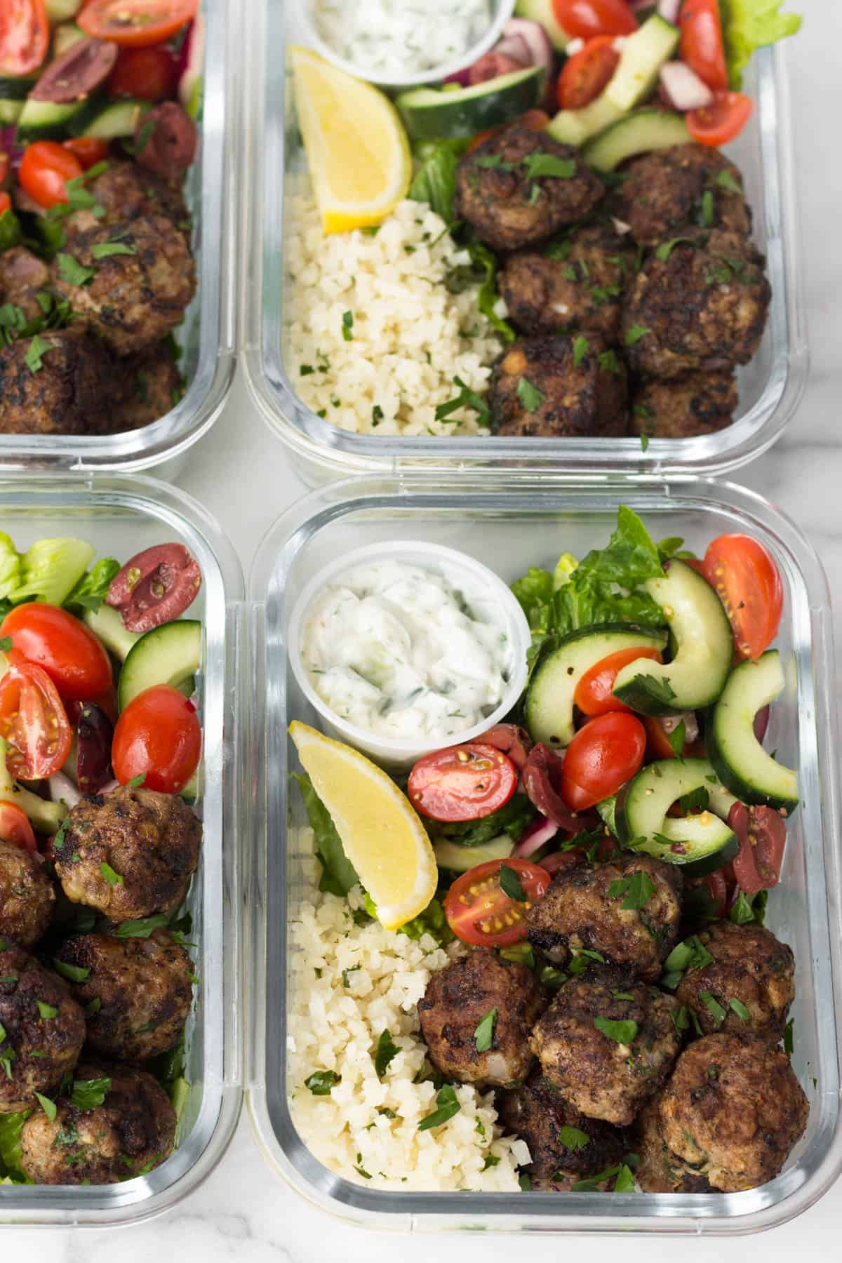 Greek lamb meatballs bowls with veggies and homemade sauce. Meal Prep Lunch Recipes