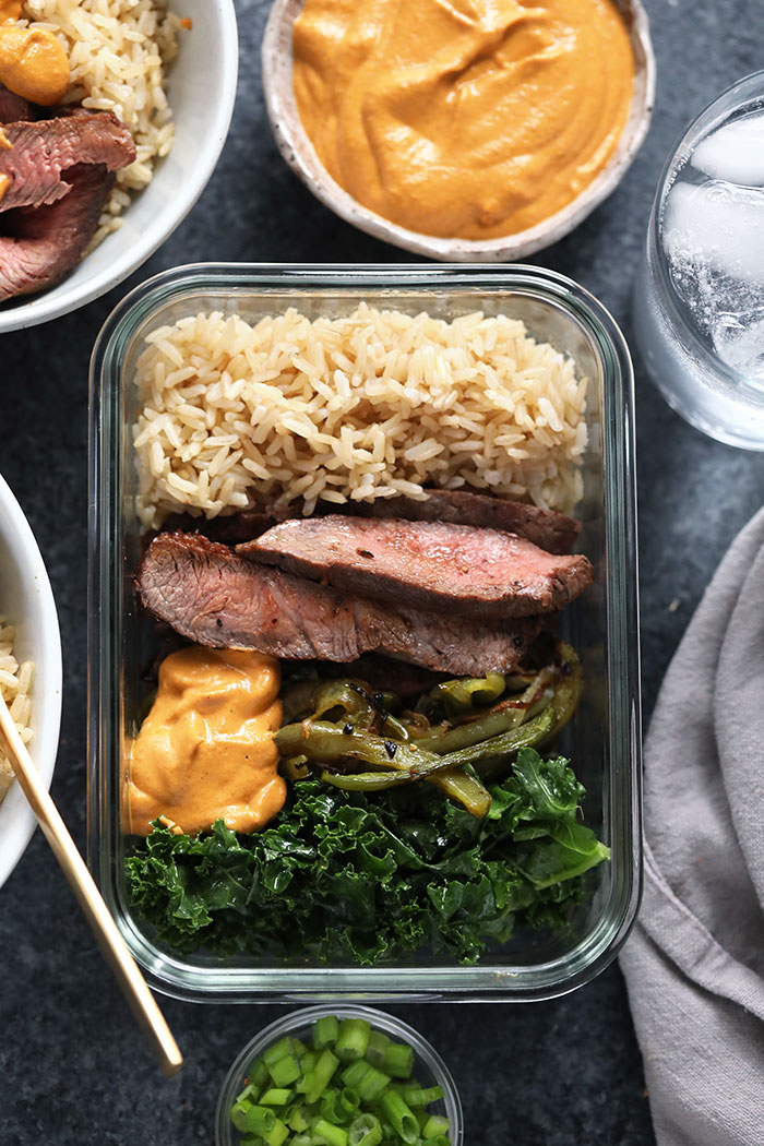 Healthy Philly Cheesesteak Bowls with flank steak, brown rice, veggies and vegan queso. Meal Prep Lunch Recipes
