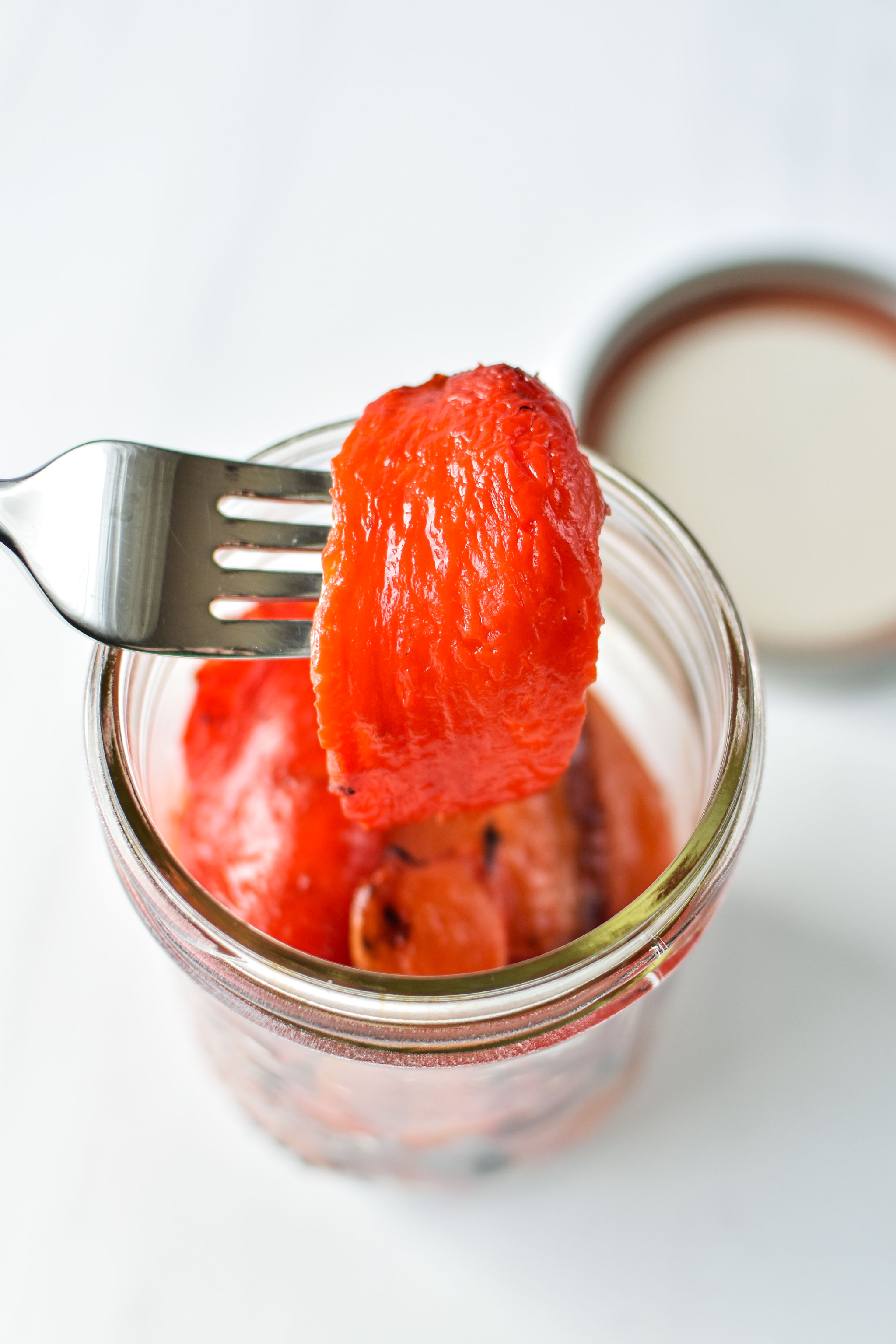 homemade roasted red bell peppers in a jar