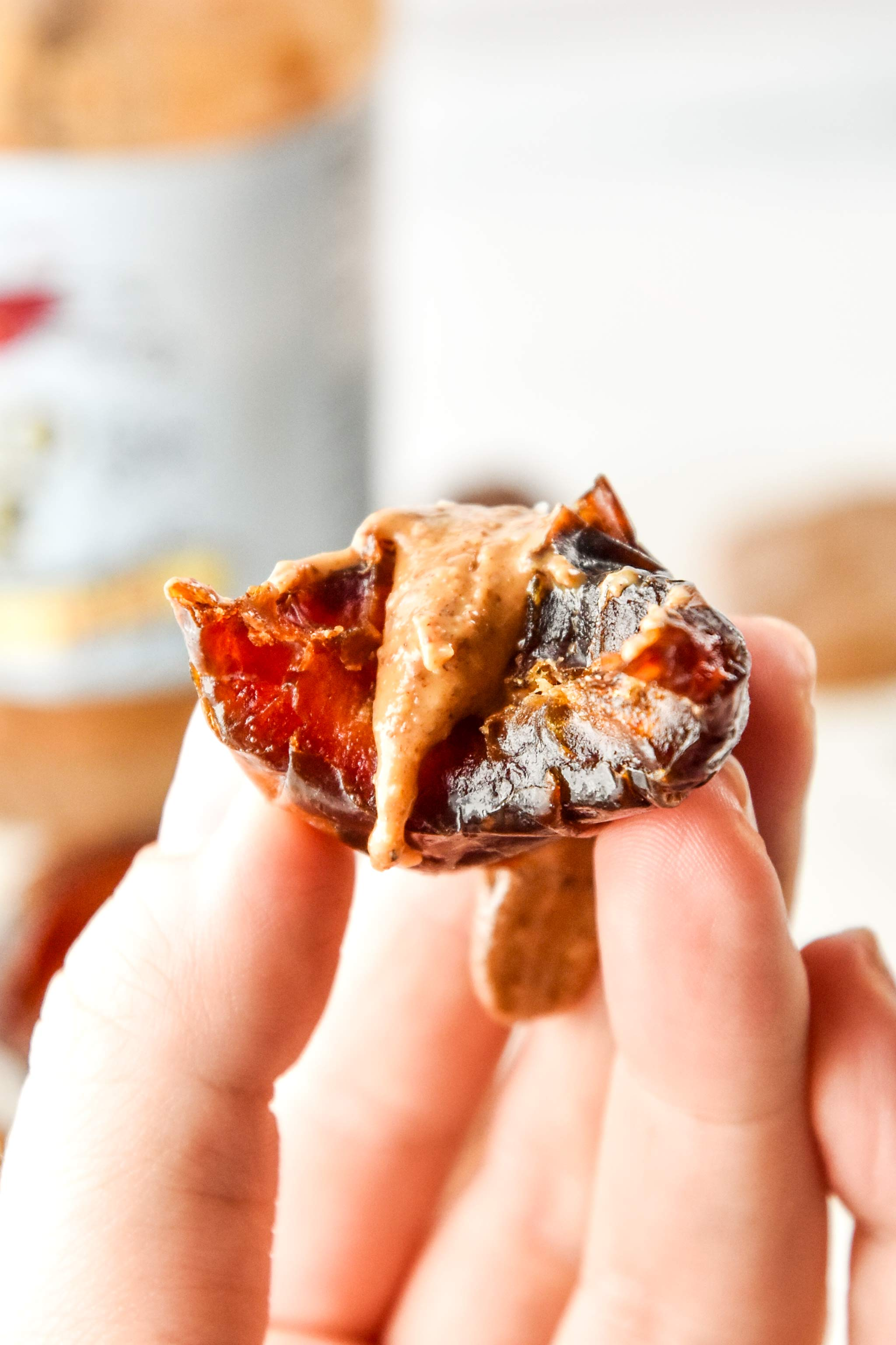 salted almond butter stuffed dates with a bite taken out