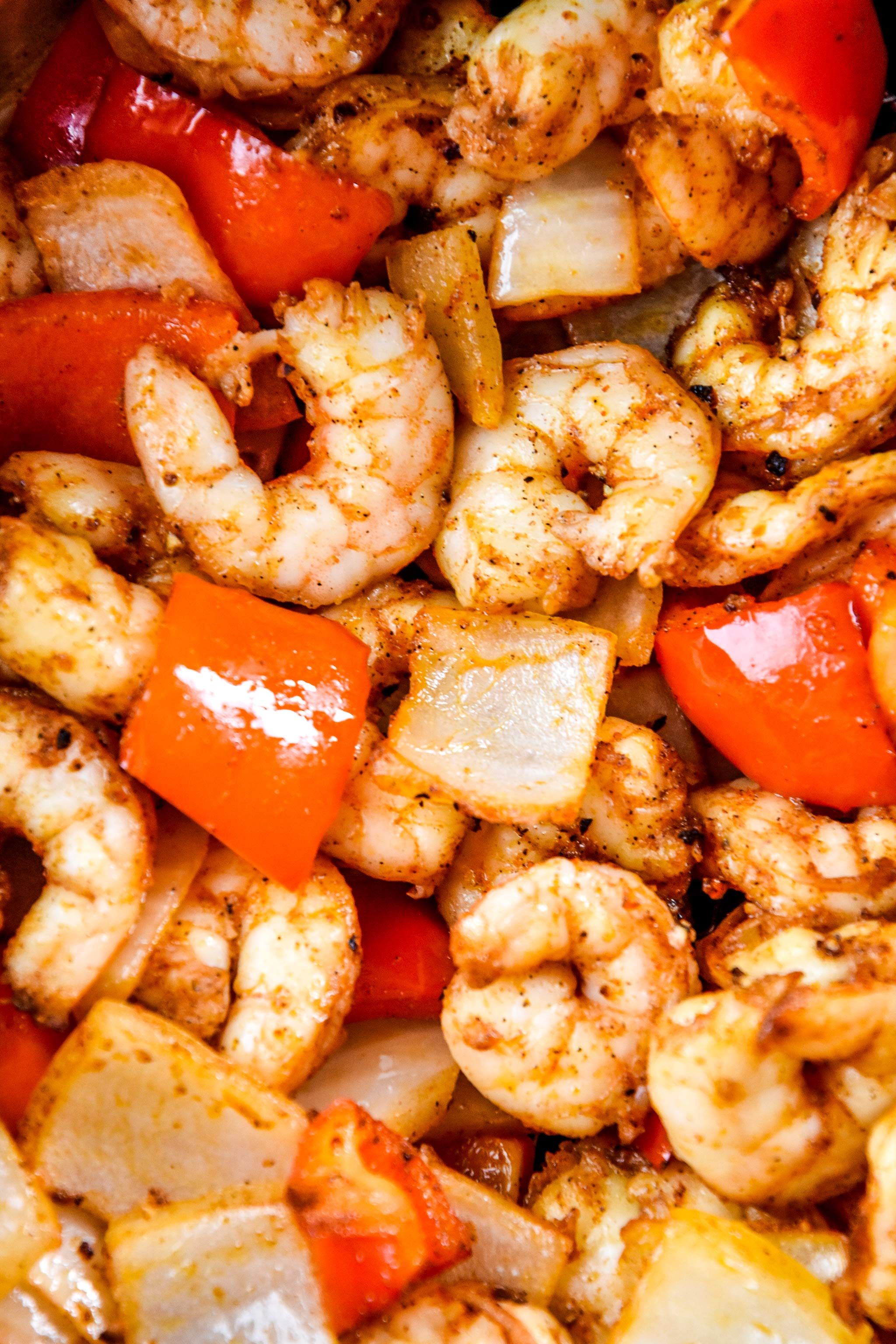close up of the shrimp, bell peppers and onions