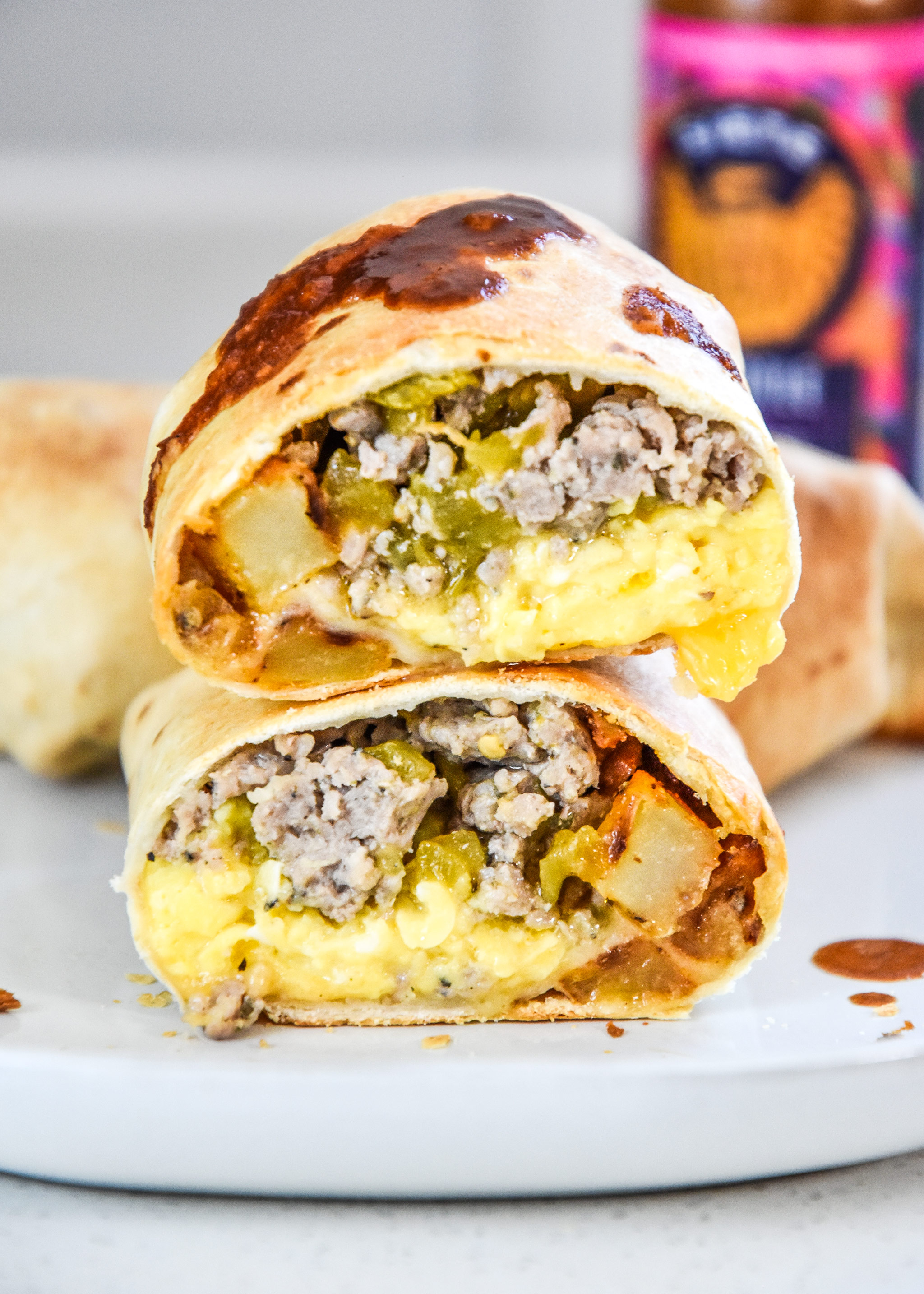 a cooked air fryer breakfast burrito cut in half